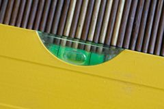 Spirit Yellow level tool close-up, for industrial background or texture.  Stock Photography