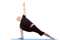 Spirited man practices yoga isolated on white. Background Stock Photography