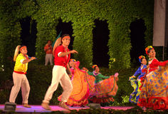 Spirited  Mexican dance. Mexican folkloric ensemble in colorful costumes  spirited dance performance Royalty Free Stock Photography