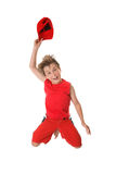 Spiritied Happy Boy Jumping. Woo Hoo!  A jubilant enthusiastic boy leaps into the air having fun Stock Photos