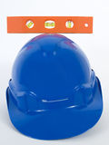 SpiritLevelAndHardHat. Spirit Level And Hard Hat Royalty Free Stock Images
