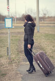 Spirito sveglio della donna per un bus Fotografia Stock