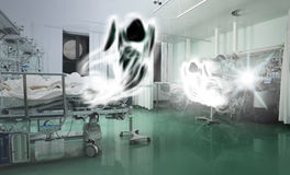 Spirits flying above the critically ill patients. Ð¡oncept of struggle between life and death royalty free stock image