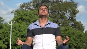 Spiritual Adult Hispanic Man Meditating. A handsome adult hispanic man stock video
