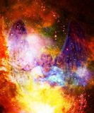 Spiritual Angel in cosmic space. Painting and graphic effect. Royalty Free Stock Images