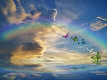 Free Spiritual Background For Meditation With Clouds Sky, Rainbow And Butterflies Stock Images - 178731544