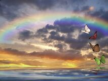 Spiritual background for meditation with clouds sky, rainbow and butterflies