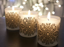 Spiritual Candles. Closeup view of soft elegant candles with blurred lights in the background royalty free stock photo