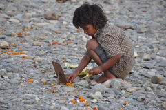 Spiritual Child Worships/Offer Puja, Ganges River, Rishikesh, India Stock Image