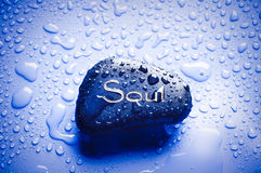 Spiritual concept. A stone with the word soul over backgroudn with drops of water like a spiritual concept Royalty Free Stock Image