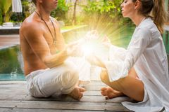 Spiritual couple finding peace and harmony. In the morning by the pool stock images