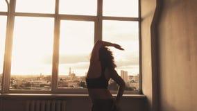 Spiritual dance woman free movements studio window