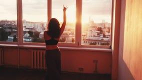 Spiritual dance woman sunset studio urban view