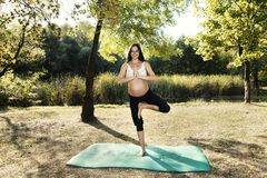 Spiritual Energy Pregnant Woman Yoga Practice. Selective focus Royalty Free Stock Images