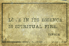 Spiritual fire Seneca. Love in its essence is spiritual fire - ancient Roman philosopher Seneca quote printed on grunge vintage cardboard Stock Photography
