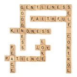 Spiritual Fruits. Scrabble tiles arranged crossword style to spell out the Bible's 9 Fruits of the Spirit. Isolated on white royalty free stock photography