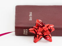 Spiritual Gift .The Bible, Word of God as Valuable Present. Spiritual present. Transmitting religion through a valuable gift. The Bible, the Word of God given to Royalty Free Stock Image