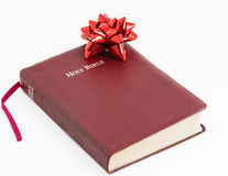 Spiritual Gift .The Bible, Word of God as Valuable Present. Spiritual present. Transmitting religion through a valuable gift. The Bible, the Word of God given to Stock Photography