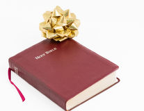 Spiritual Gift .The Bible, Word of God as Valuable Present. Spiritual present. Transmitting religion through a valuable gift. The Bible, the Word of God given to Royalty Free Stock Photos