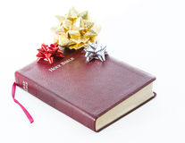 Spiritual Gift .The Bible, Word of God as Valuable Present. Spiritual present. Transmitting religion through a valuable gift. The Bible, the Word of God given to Stock Image