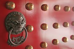 Spiritual Guardian Found on Traditional Chinese Do. The majestic door guardian commonly found on traditional asian doors stock photos