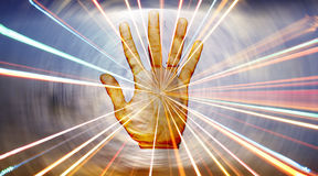 Spiritual Healing Hand. A metaphorical background showing energies radiating from the hand of a spiritual healer Royalty Free Stock Photos