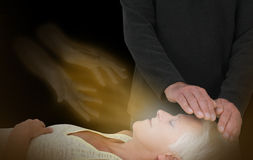 Spiritual Healing Session. Male healer channeling healing energy to female with the help of a spirit healing guide Royalty Free Stock Image