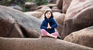 Spiritual kid relaxing, praying and breathing alone for yoga outdoor Stock Photography