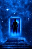 Spiritual man. Mystical door and stairs with man silhouette enetering in Universe like a symbol of spiritual philosophy Stock Image