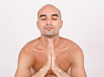 Spiritual man praying and meditating. Royalty Free Stock Photo