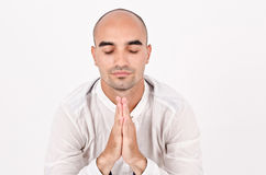 Spiritual man praying and meditating. Royalty Free Stock Images