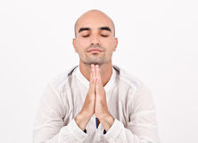 Spiritual man praying and meditating. Royalty Free Stock Photography