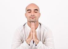 Spiritual man praying and meditating. Man with hands closed, praying. Man doing yoga royalty free stock photography