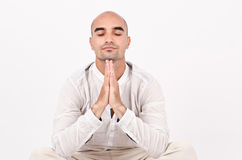 Spiritual man praying and meditating. Royalty Free Stock Image