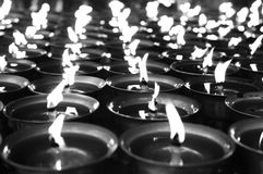 Spiritual oil lamps in temple - black and white filter Royalty Free Stock Photography