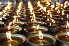Spiritual oil lamps in temple Stock Photos