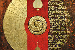 Spiritual painting with spiral symbol, gold and re Royalty Free Stock Images