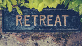 Spiritual Retreat Sign. Retro Styled Image Of A Hidden Sign For A Spiritual Retreat Stock Images