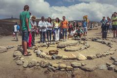 Spiritual ritual. Bucegi Mountains, Romania - August 6, 2016: People attend a spiritual ritual organized around a spiral of stones near the Sphinx, the sacred Royalty Free Stock Photography