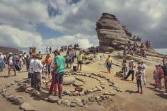Spiritual ritual at Sphinx, Bucegi mountains, Romania. Bucegi Mountains, Romania - August 6, 2016: Tourists participate to a spiritual ritual organized around a Stock Image