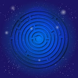 Spiritual sacred symbol of labyrinth on the deep blue cosmic sky. Sacral geometry in universe. Royalty Free Stock Images