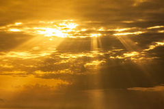 Spiritual sky with  light rays. Spiritual  sunset sky with descending light rays going through clouds Royalty Free Stock Photo