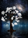 Spiritual Tree. Tree surrounded by clouds in mysterious landscape Royalty Free Stock Images