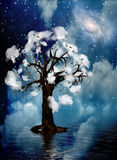 Spiritual Tree. Tree surrounded by clouds in surreal landscape Stock Photos