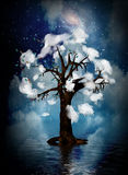 Spiritual Tree. Tree surrounded by clouds in surreal waterscape Royalty Free Stock Photos