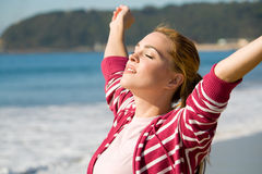Spiritual woman. A spiritual woman with arms open wide on beach Stock Image