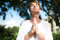 Spiritual Woman. A beautiful woman praying outside Royalty Free Stock Photos