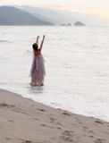 Spiritual woman. On the beach Stock Image