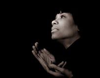 Spiritual Woman. Beautiful Spiritual Image of a Afro American Woman in Prayer Royalty Free Stock Image