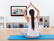 Spiritual woman meditating at home Royalty Free Stock Image
